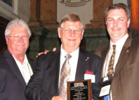 Recipient Ron Underwood with Chuck Wuttke (L) and John Underwood (R)